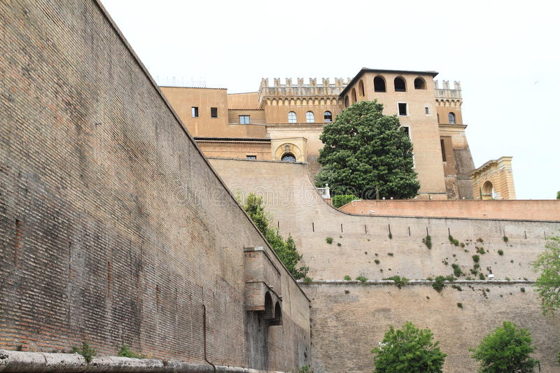 Vatican Museum. Buildings of Vatican Museum above brick wall around Vatican city in Rome, Italy stock images