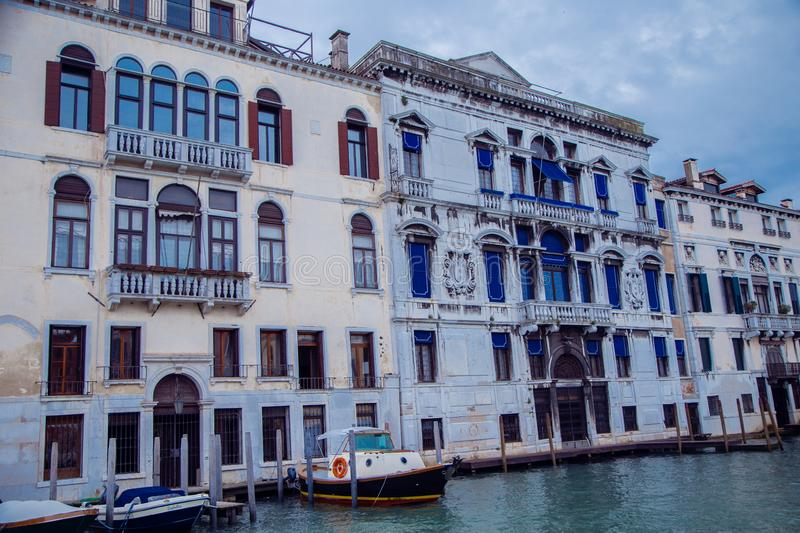 Buildings in Venice along the Grand canal. Italy. Buildings in Venice along the Grand canal against the blue sky. Italy royalty free stock photos