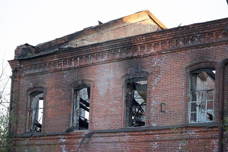 Builing after a fire. Burned windows and roof royalty free stock image