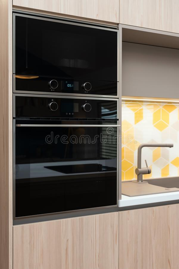 Built-in appliances in a kitchen. Built-in appliances in contemporary kitchen stock image