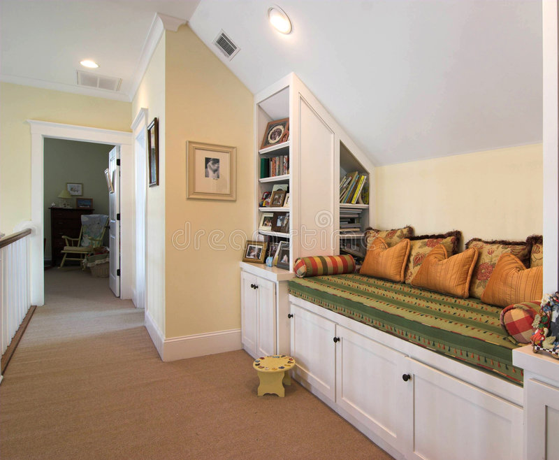 Built-in bench and nook. Recessed nook with bench in home for reading area stock photos