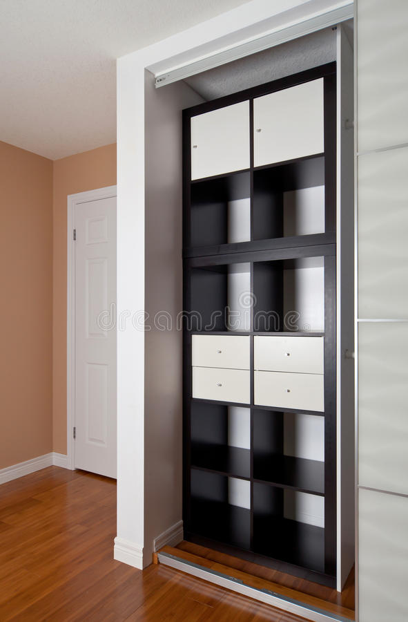 Built In Closet With Sliding Door Shelving Storage Organization Solution,  Empty Shelves