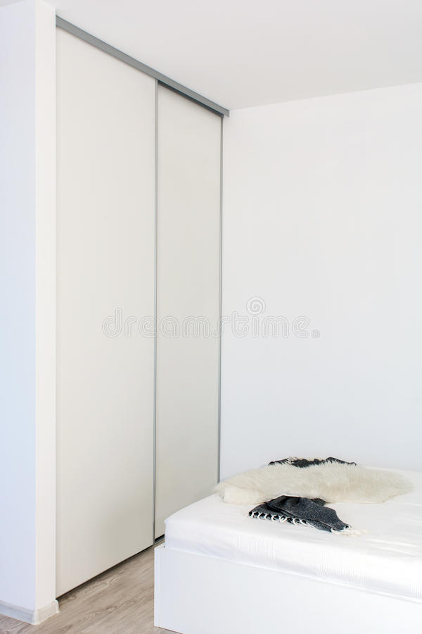 Free Built-in Wardrobe In The Light Interior Of The Bedroom. Stock Photos - 94611593