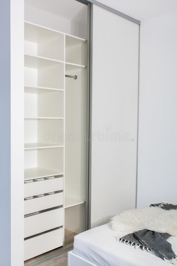 Free Built-in Wardrobe In The Light Interior Of The Bedroom. Stock Photography - 94611632