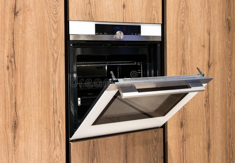 Built in oven in wooden fitted cabinets stock images
