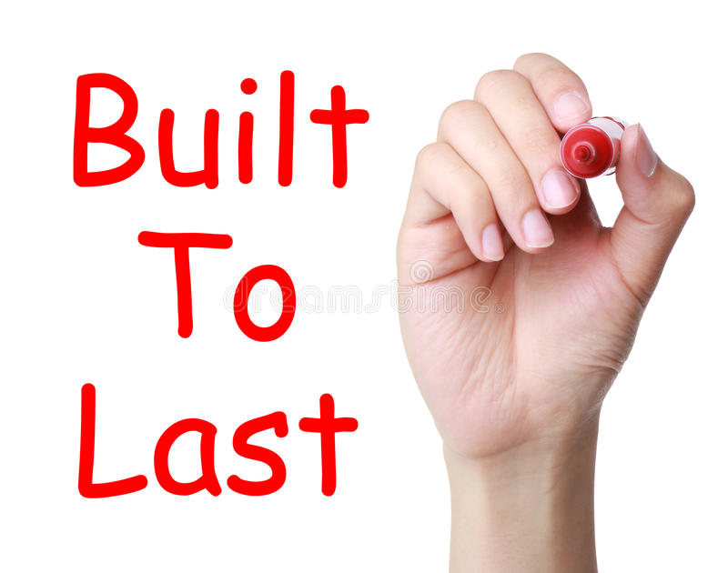 Built To Last. Hand with red marker writing Concept Built to last isolated on white background royalty free stock image