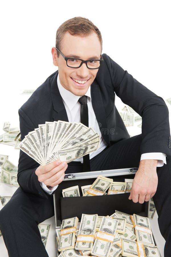Buinessman rico. imagens de stock