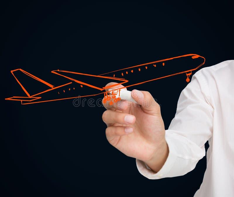 Buisnessman che estrae aeroplano arancio fotografie stock libere da diritti