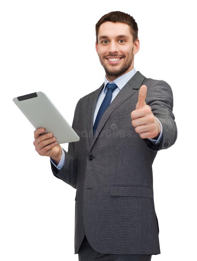 Buisnessman sorridente con il computer del pc della compressa immagini stock