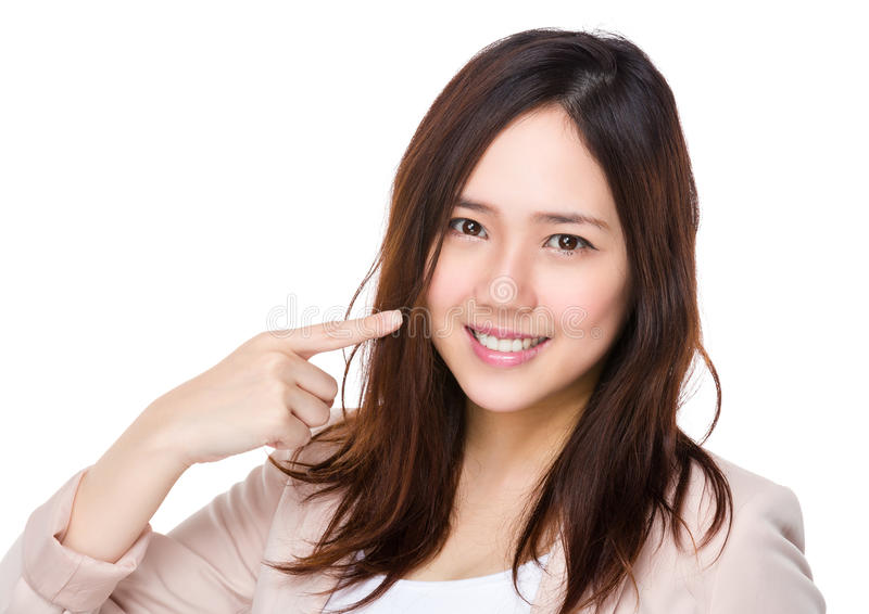 Buisnesswoman finger point to her teeth royalty free stock images