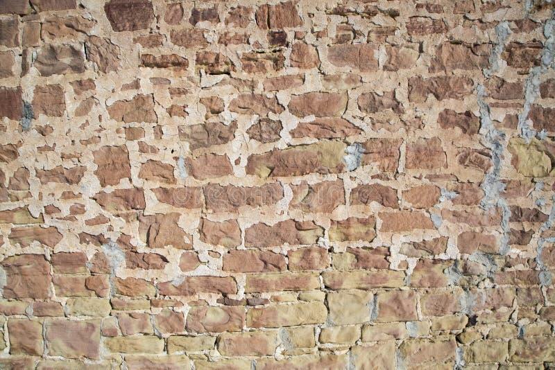 Buiten het cementmetselwerk van de rotsmuur stock fotografie
