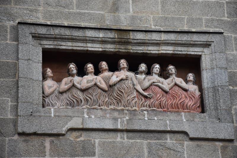 Buitenbeeldhouwwerk van zielen in vagevuur in Capela DE Animas, stock fotografie