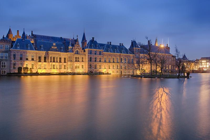 Buitenhof, Houses of the Dutch Parliament in the Hague. The Houses of Dutch Parliament in the evening with a light reflection of the trees on the water