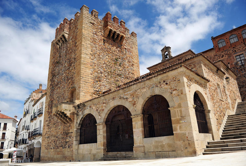 Bujaco tower and Ermita de la Paz in Main Square, Caceres, Extremadura, Spain. Main Square, Arc of the Star, Ermita de la Paz and Bujaco tower in Caceres royalty free stock image