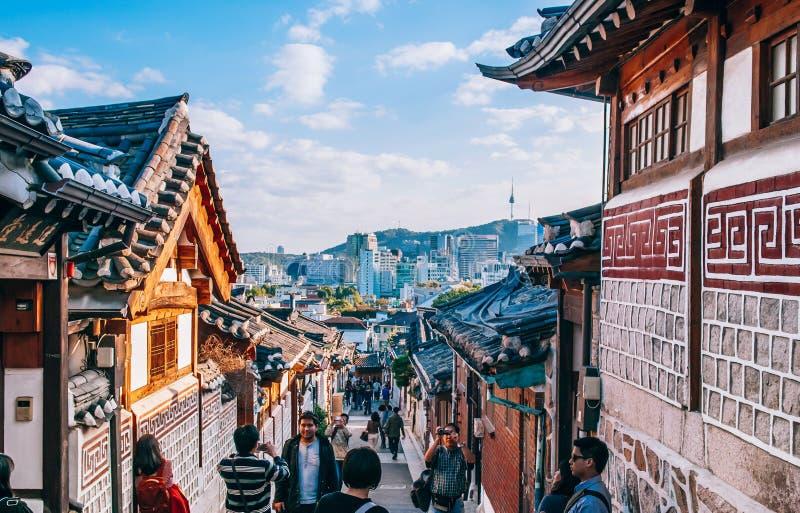 Bukchon Hanok Village, old traditional Korean house with tourist. OCT 27, 2013 Seoul, South Korea - Bukchon Hanok Village, old traditional Korean house stock photo