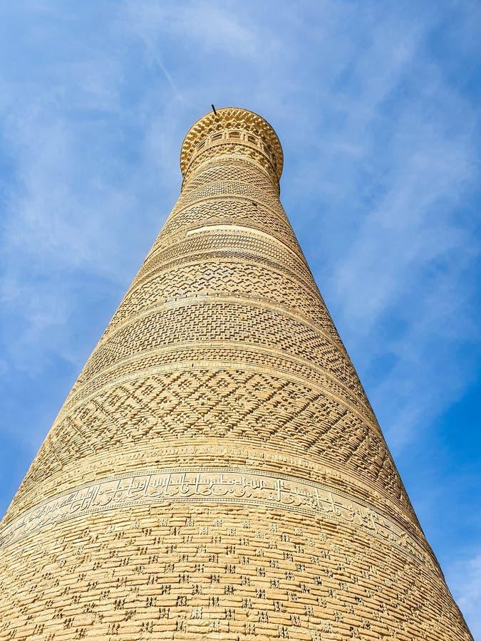 Bukhara Ásia Central Kalyan minaret faz parte do POI - Conjunto arquitetônico Kalyan, um dos mais antigos monumentos arquitetônic imagem de stock royalty free