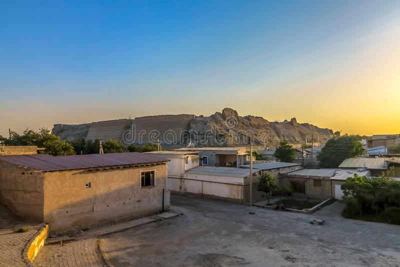 Bukhara Old City 119. Bukhara Old City Ark Citadel Fortified Walls Back View with Residential Houses at Sunset stock images