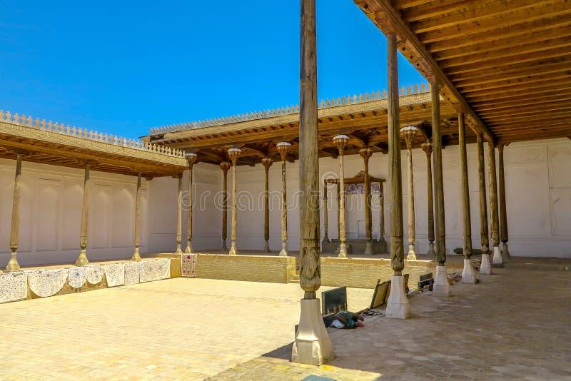 Bukhara Old City 19. Bukhara Old City Ark Citadel Courtyard with Wooden Columns and Souvenir Sellers stock photo