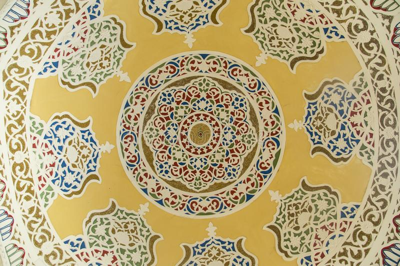 Bukhara, Uzbekistan - March 13, 2019: Traditional Islamic ornament elements painted inside of the dome stock photos