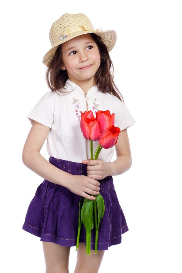 bukieta dziewczyny mienia uśmiechnięci tulipany obraz stock
