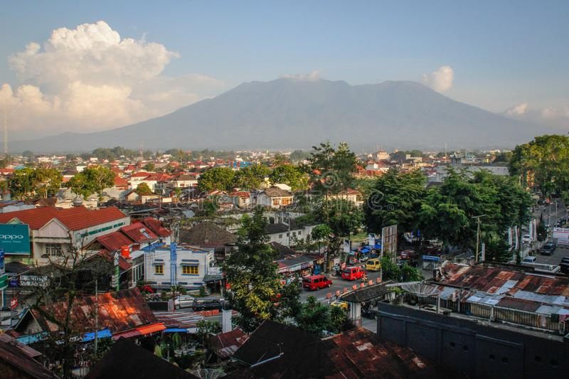 Panoramic view of the city from above and the volcano stock image