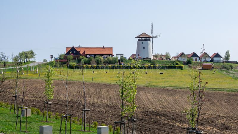 Bukovany, Czech Republic / Southern Moravia - April 18, 2020: Bukovany wind mill and orchard with field.  royalty free stock photos