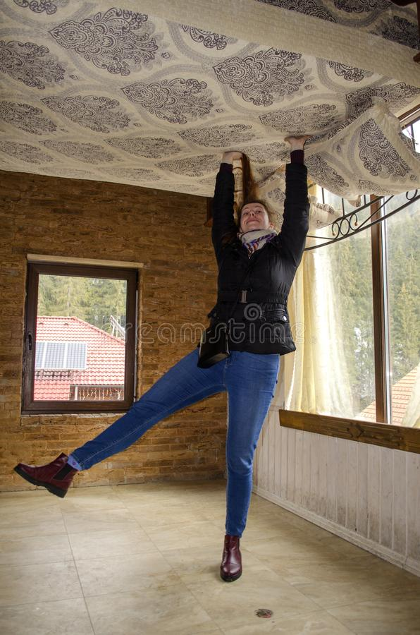 Free BUKOVEL, IVANO FRANKIVSKAYA OBLAST, UKRAINE- April 2, 2018: Unusual Foreshortening Of The Girl Holding The Bed Stock Image - 114917381