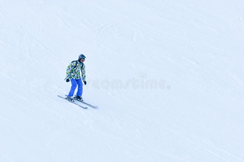 BUKOVEL, UKRAINE- 27 JANUARY 2018: Man skiing down the snow-covered slope royalty free stock photography