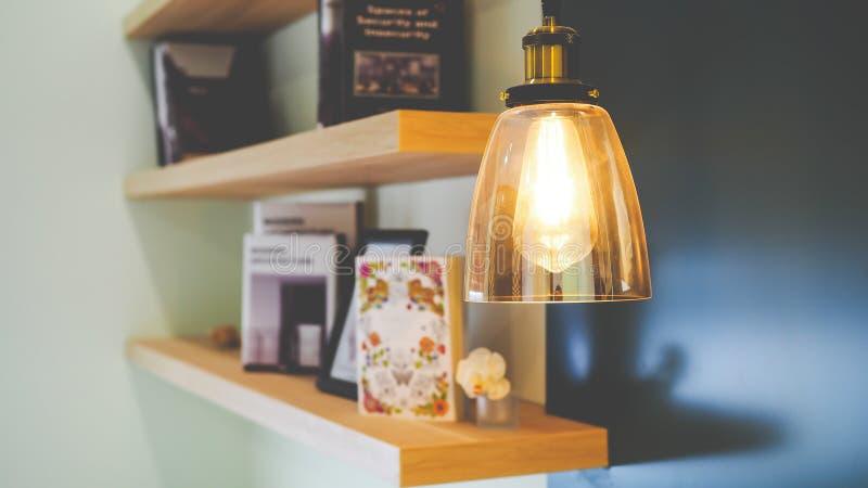 Bulb and Bookshelf. Decorative Bulb and Bookshelf Concept stock photography