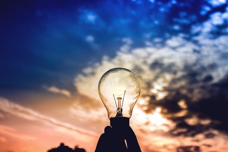Bulb on dramatic blue and pink sky stock photos