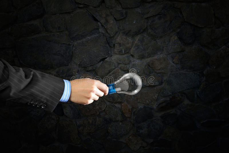 Bulb in hand. Close up of businessman hand holding glass light bulb royalty free stock photos