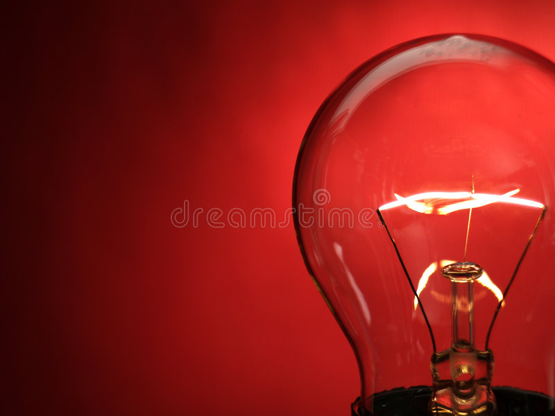 Bulb light. A bulb light on red background royalty free stock images