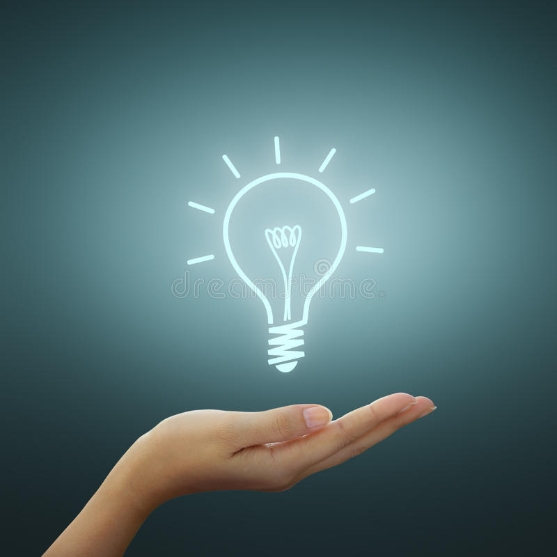 Free Bulb Light Drawing On Hand Stock Photography - 22743452