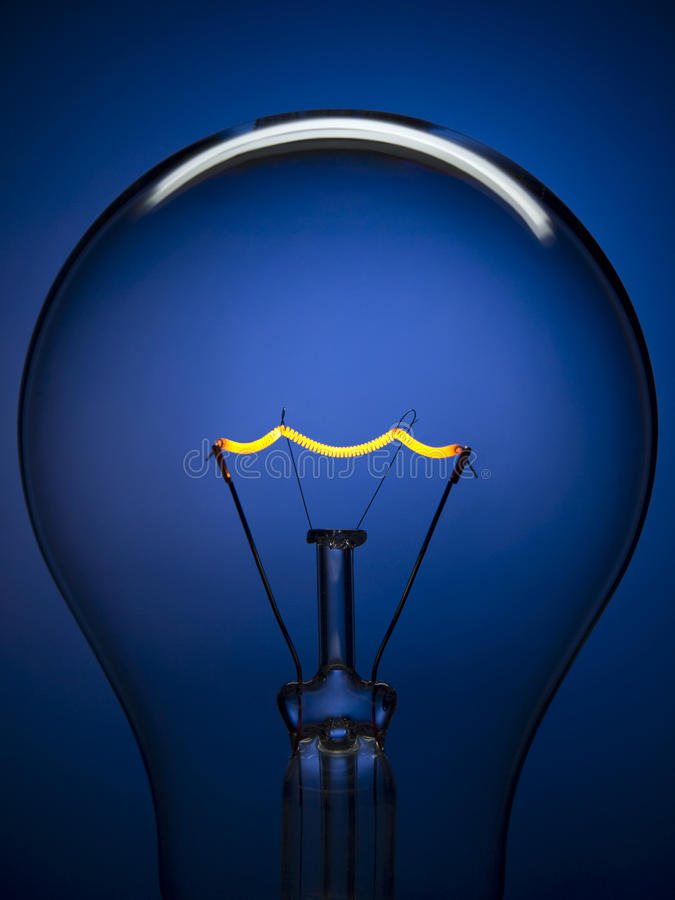 Bulb light over blue royalty free stock photography