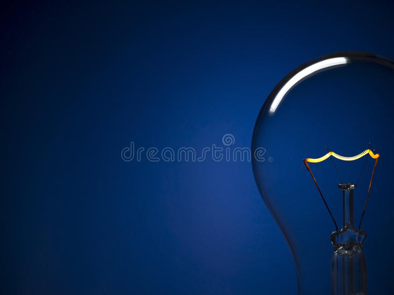 Bulb light over blue royalty free stock photo