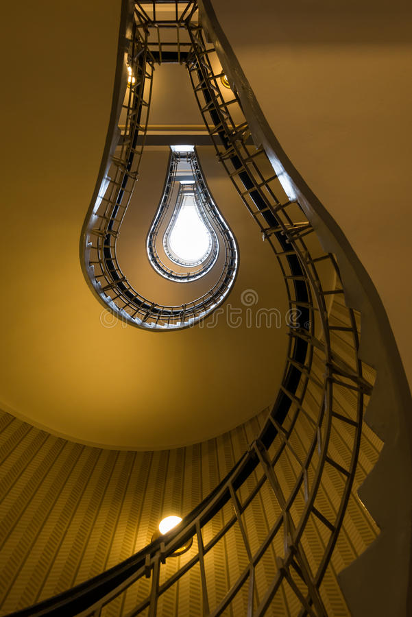 The bulb. Light bulb shaped cubism staircase in historical building in the centre of old Prague stock images