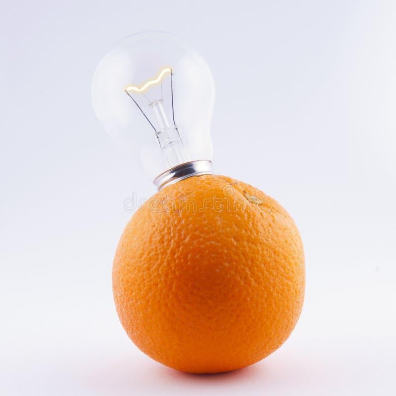 Bulb in orange - energy fruits. On white background stock photo