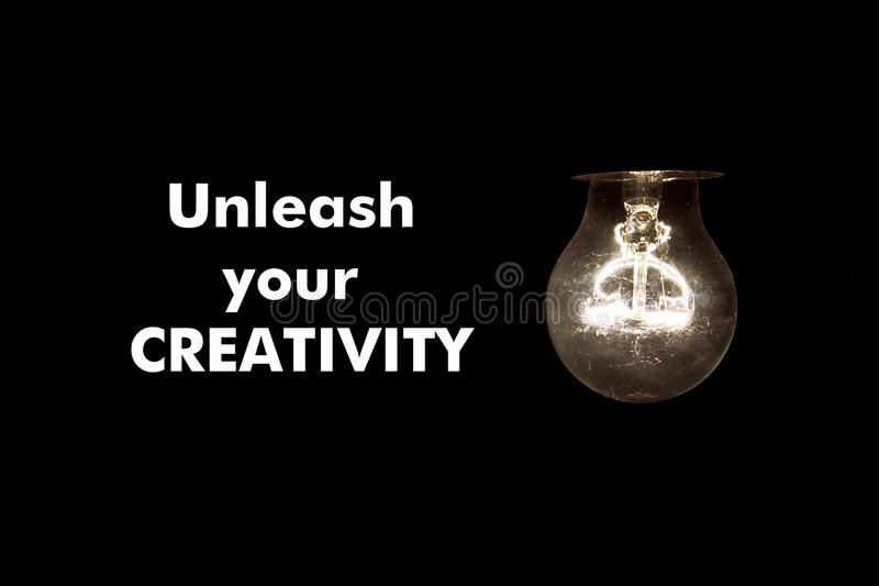 Bulb with text UNLEASH YOUR CREATIVITY royalty free stock photo