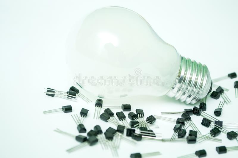 The bulb and the transistors isolated. On a white background royalty free stock photos