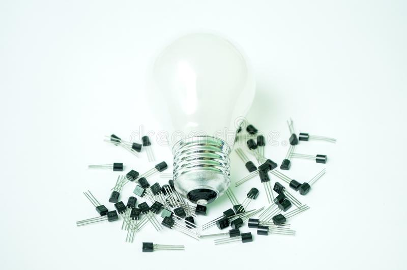 The bulb and the transistors isolated. On a white background stock photo