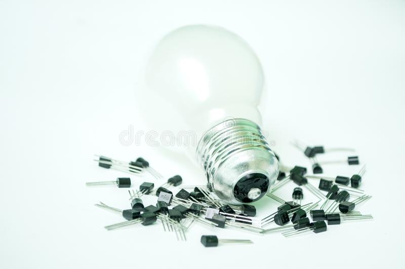 The bulb and the transistors isolated. On a white background stock photos