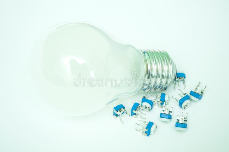 The bulb and the transistors isolated. On a white background royalty free stock photography