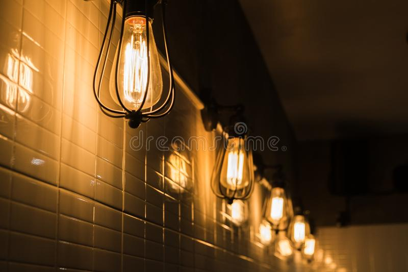 Bulb vintage style hanging on wall textile royalty free stock photos