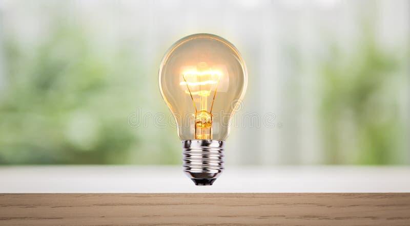 Bulb on wood shelf. Lighting royalty free stock photo