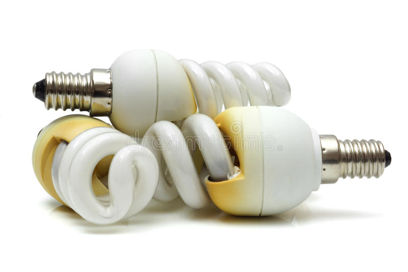 Bulbos incandescentes fluorescentes usados quemados viejos fotos de archivo