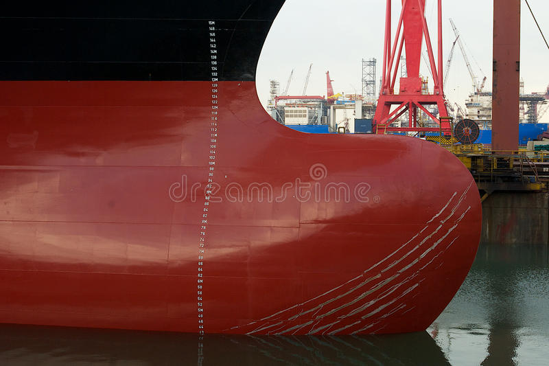 Bulbous Bow. Of a modern containership with marks from anchor chain rubbing against it royalty free stock images