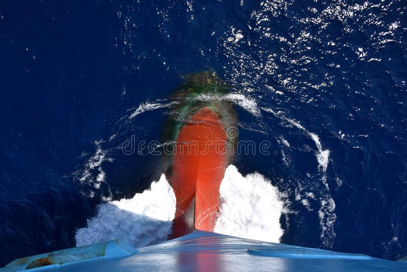 Bulbous bow of the cargo ship sailing through the ocean. Bulbous bow of the cargo ship sailing through the ocean on the sunny day stock image