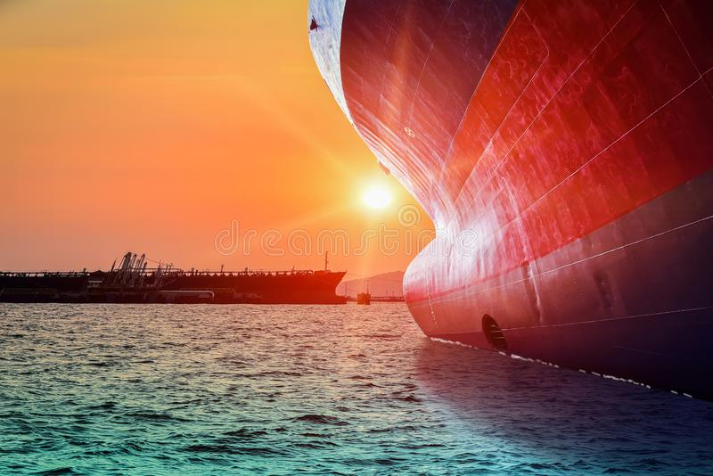 Bulbous bow ship sailing in the sea with sunset. Bulbous bow ship, Big Cargo ship sailing in the sea with sunset go to Logistics and international shipping stock photography