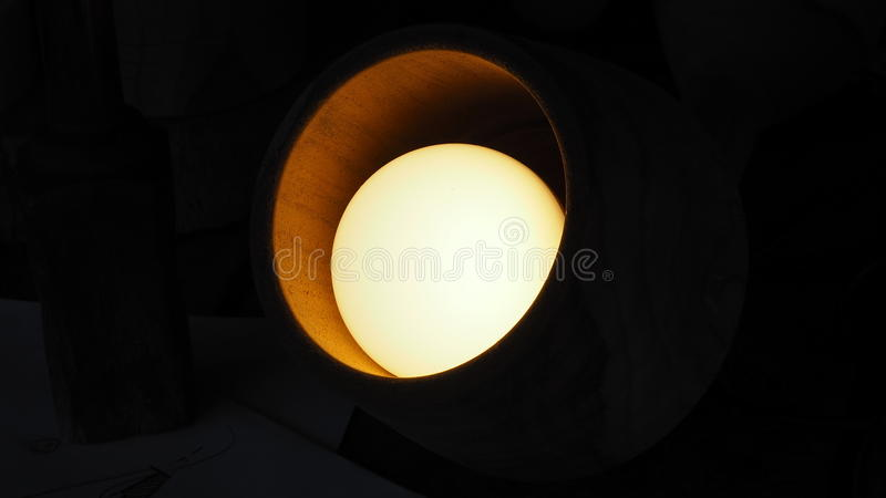 Bulbs in the lamps made of wood. stock images