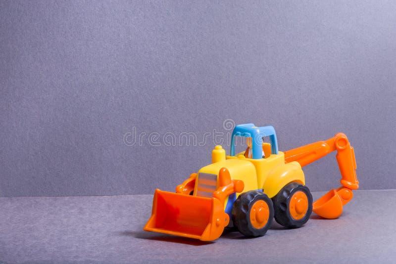 Buldozer giallo Automobile della pala Trasporto di costruzione Giocattoli per l'illustrazione di children fotografie stock libere da diritti